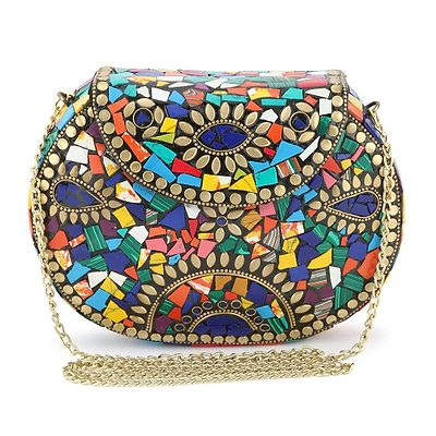 Rajasthani metal clutch oval shaped made up of all brass looks like a fine piece of gold with colorful stones engraved on it.