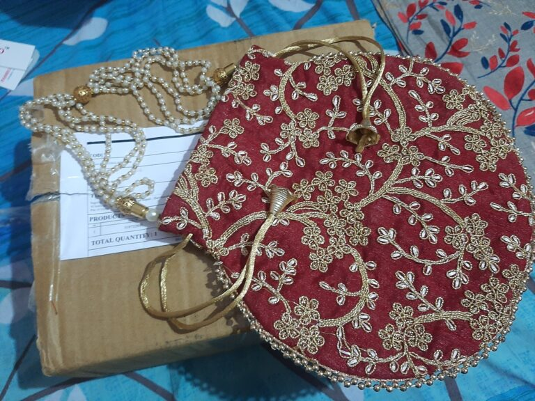 Rajasthani Bag made from Raw Silk With The Enrichment Of Embroidery, Sequin, Beads and Pearls
